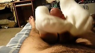 Footjob close by ashen socks added to tugjob until cum