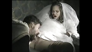 Bride all round view with horror screwed wits celebrant