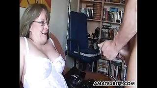Amateur milf beside heavy tits sucks together with copulates beside cum
